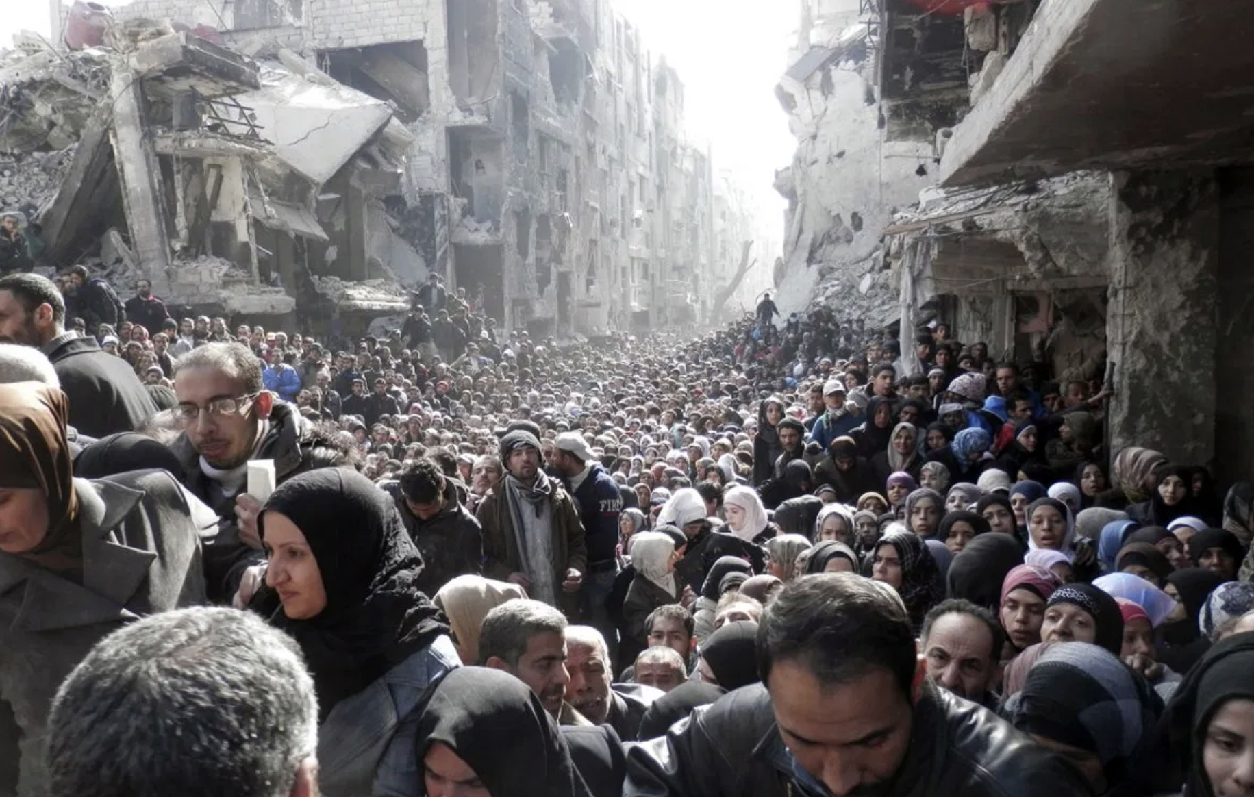Syrian Refugees Waiting For Food Distribution